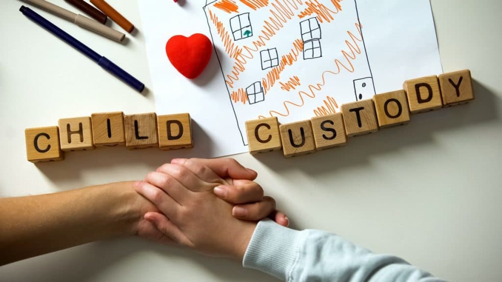Child Custody on wooden blocks, along with a child's drawing